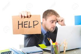 Young Desperate Businessman Holding Help Sign Looking Worried