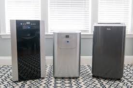 haier 14000 btu portable air conditioner. three portable air conditioners -- one black, silver, and grey - haier 14000 btu conditioner
