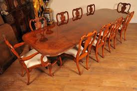 piece description english regency style pedestal dining table in walnut with matching set of queen anne chairs