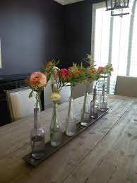 rustic dining room table centerpieces. modern dining room design with minimalist floral table centerpiece, recycle glass bottle flower vase rustic centerpieces t