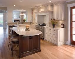 it include a big wooden hood and furious lamp that provide the kitchen with magic lighting traditional kitchens succeed on tried styles