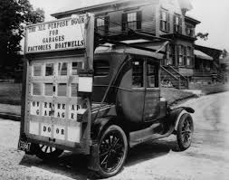 1921 c g johnson recognizes the need for an efficient way to house the vehicles indoors and out of the elements without using side opening panel doors