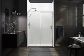 hinged shower doors open outwards pivoting at the corner hinges are
