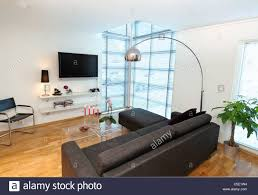 cool lights living. View Of Floor Lamp Over Black Sofa Set With Flat Screen Tv At Modern Stock Photo Living Room In The House Sectional Lighting Lamps Affordable Red Rustic Cool Lights