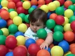 ball pit for babies. baby in the ball pit for babies e