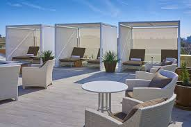 cabanas around the rooftop pool at the clement palo alto photo the clement palo alto