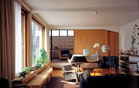 The Aalto House living room with a sliding door to the studio behind   Photo by