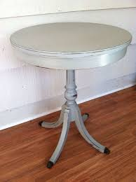 round side table painted gray