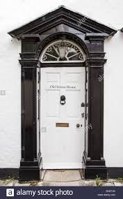 white front door detail of traditional english house with black lion door knocker br