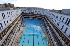 swimming in luxury an iconic pool is reborn in paris the verge a view of the outdoor pool from above joyce attali