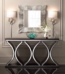 A rich chocolate brown finish enhances the distinctive design of this  spacious contemporary console table that