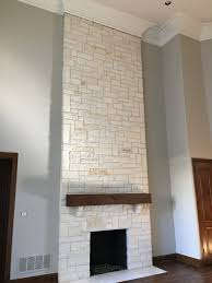 White Austin Stone fireplace After photo with Revere Pewter (Benjamin  Moore) on walls.