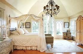 iron canopy bed bedroom with white curtain and metal frame also hanging chandelier for four poster
