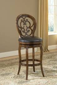 Gothic inspired scroll work adds a unique elegance to the Alexandra swivel  stool. With an air of old world charm this stool's dark tobacco finish  enhances ...