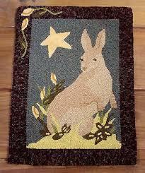 primitive hooked rug pattern on linen bunny beauty