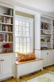 groton ma renovation with built in window seat and storage in custom bookcases