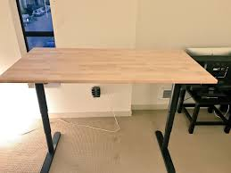 Instructions for how to affix an Ikea Gerton table top to the Ikea Bekant  sit-