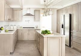 cozy country kitchen stone  tan cabinets