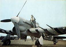 rare wartime colour photograph of an unidentified typhoon showing the black and white identification stripes under the wings