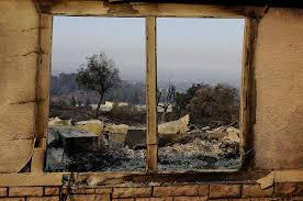 an exterior window frames a home destroyed by fires in santa rosa calif