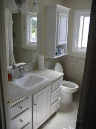 white wooden bathroom furniture. Bathroom. Bathroom With White Wooden Flatong Cabinet Over Toilet Adde Vanity Table Sink And Furniture I