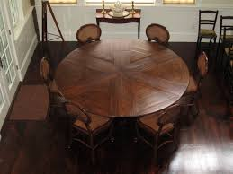 expandable round vintage dining room table with 6 antique chairs for small dining room spaces with dark brown hardwood floor tiles and white wall interior