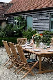 garden dining tables. Exellent Dining Rectangular Extending Teak Garden Dining Table Parasol Hole Inside Tables R
