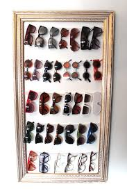 easy diy framed sungl holder for closet using thick elastic to hold the sungl