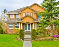 the bright marigold stucco of this home livens up the front yard and practically invites you in whichever exterior paint color you decide on make sure you