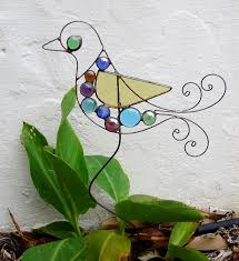 stained glass joined together to create a pretty garden art bird sculpture color varies no two pieces alike this sculpture is made in the usa by artist