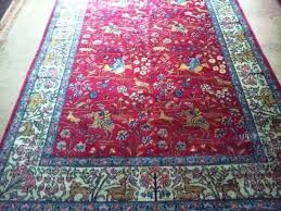 cleaning oriental rug fringe found this red hunting at an auction paid it is around 5 oriental rug