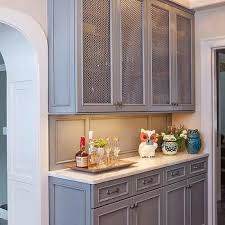 gray butler pantry cabinets with metal mesh doors