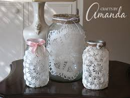 Make beautiful doily luminaries using recycled jars, doilies and a little  burlap and twine.