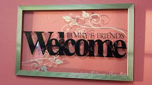 fls decorate the glass of floating frame along with welcome lettering