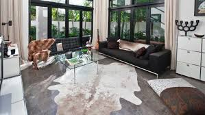 large size of living room how are cowhide rugs made rug in living room setting