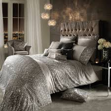 in soft silver satin and tulle delicate sequins shimmer across duvet and pillows in an art deco inspired