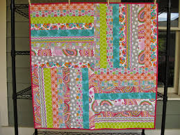 Modern Cozy: Jelly Roll Baby Quilt & I truly love making baby quilts - they come together so quickly and make  such a lovely gift, plus seeing sweet squishy babies on my quilts (babies  that I ... Adamdwight.com