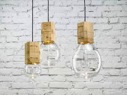 minimalist led mould lamps look like balloons extending from rustic wooden blocks