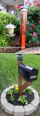 top house number wood post with a solar light