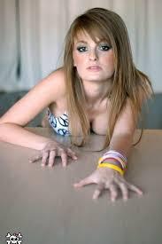 Smoking hot blonde model Faye Reagan strips her bikini and shows.