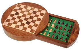 small wooden travel chess set in a round wooden box