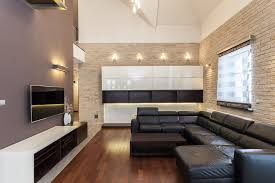 proper lighting will further enhance your living room s stone walls without illumination the texture color and beauty of the stone is lost