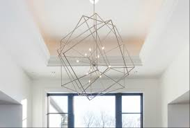 big with a geometric light that stands out and is an art piece in its own right this contemporary fixture makes a stunning accent in a home s entrance
