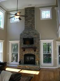 Living Room In Remodeled Home With Two Story Fireplace Stock Photo Two Story Fireplace