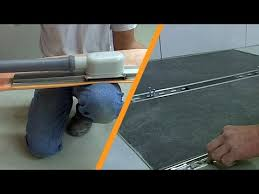 tiling a shower with linear drainage center installation