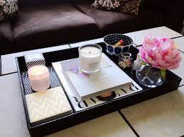 Did you ever wonder how to put a few items on a tray and make it look like they all belong together? How To Style Coffee Table Trays Ideas Inspiration Decorating Coffee Tables Coffee Table Tray Coffee Table Styling