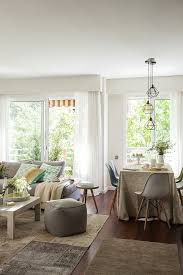 distressed and rusted this upcycled window frame adds definition to this space and we love how it also works to reflect light in
