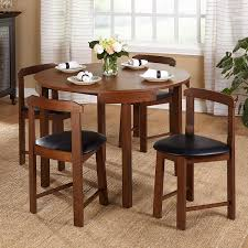 Amazon.com - Mid-Century Tobey Walnut Compact Dining Set (5 Piece) in Black  Faux Leather Upholstered Seats. Angled Chairs Fit Seamlessly to Edge of  Table.