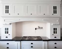 in style kitchen cabinets:  white shaker style cabinets do you see that tall skinny door in front of you