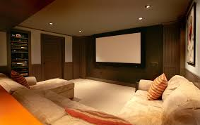 basement home theater room. designs ideas:traditional basement theater with simple sectional sofa and wall mounted media storage remodeling home room